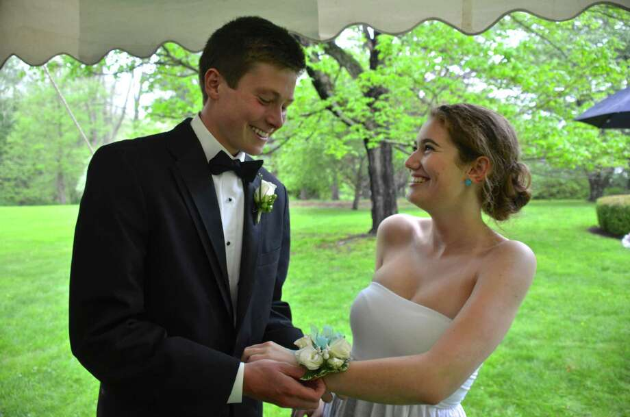 Henry Holbrook and Charlotte Rosenberg exchange boutonniere and corsage at a New Canaan High School senior pre-prom party on May 16, 2014. Photo: Jeanna Petersen Shepard, Freelance Photo / New Canaan News freelance