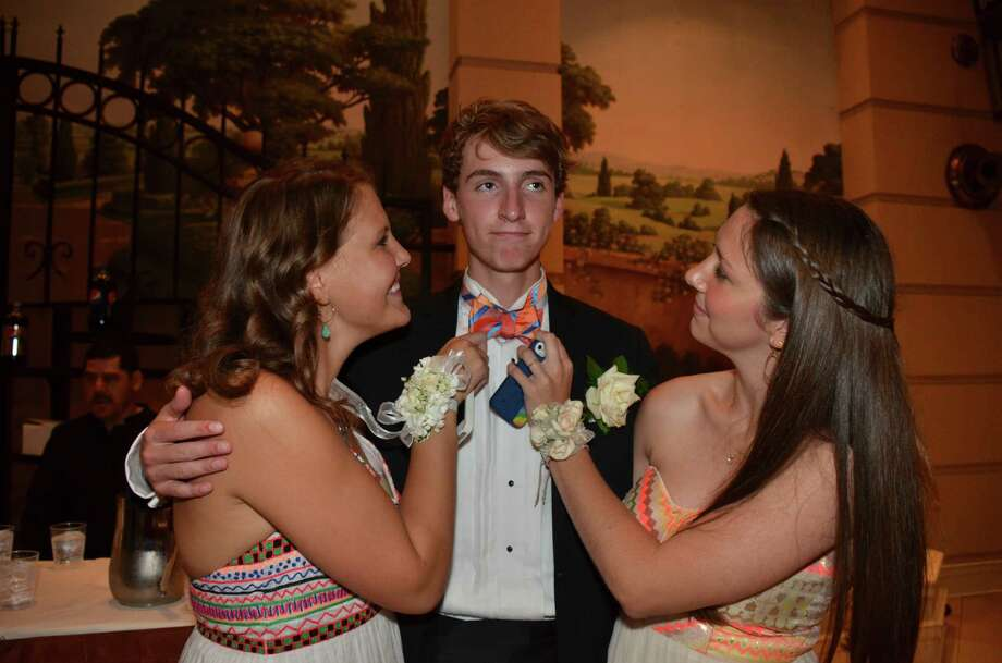 Jeffrey Cole gets some attention from Astrid Toft-Nielsen and Caroline Muller, at the New Canaan High School Senior Prom, held at the Marriott Hotel in Stamford, Connecticut, on May 16, 2014. Photo: Jeanna Petersen Shepard, Freelance Photo / New Canaan News freelance