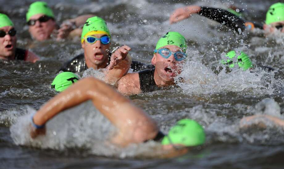 Competiors swim during the Ironman Texas triathlon, Saturday, May 17, 2014, in The Woodlands. (Photo: Eric Christian Smith/For the Chronicle) Photo: Eric Christian Smith, For The Houston Chronicle