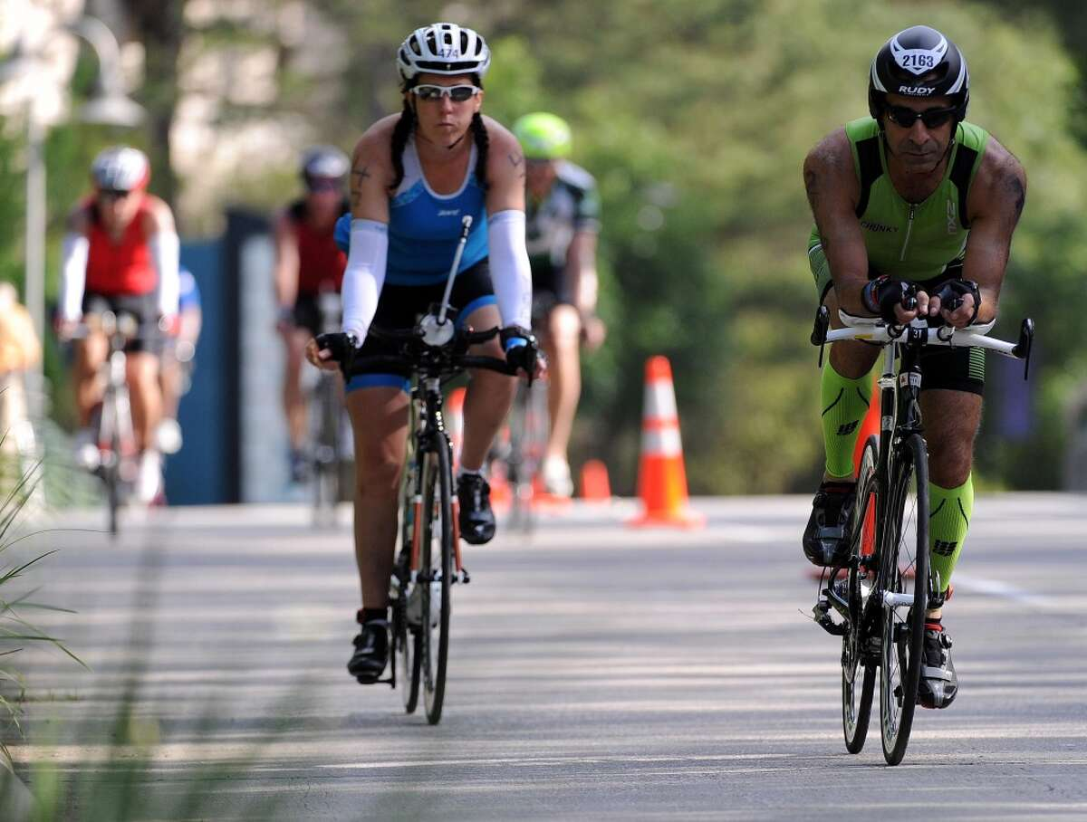 Mehdi Balouchestani, right, and Tracy Hood cycle during the Ironman Texas triathlon, Saturday, May 17, 2014, in The Woodlands. (Photo: Eric Christian Smith/For the Chronicle)