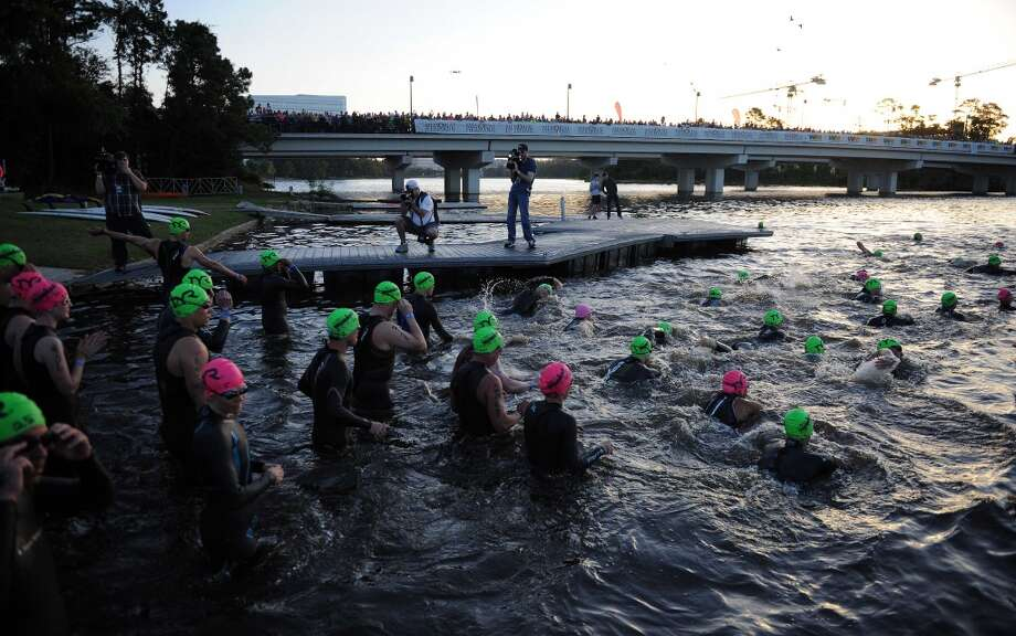 Competitors enter Lake Woodlands for the swimming portion of the Ironman Texas triathlon, Saturday, May 17, 2014, in The Woodlands. (Photo: Eric Christian Smith/For the Chronicle) Photo: Eric Christian Smith, For The Houston Chronicle