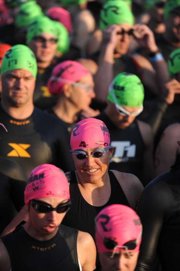 Competitors wait to enter Lake Woodlands before the swimming portion of the Ironman Texas triathlon, Saturday, May 17, 2014, in The Woodlands. (Photo: Eric Christian Smith/For the Chronicle) Photo: Eric Christian Smith, For The Houston Chronicle