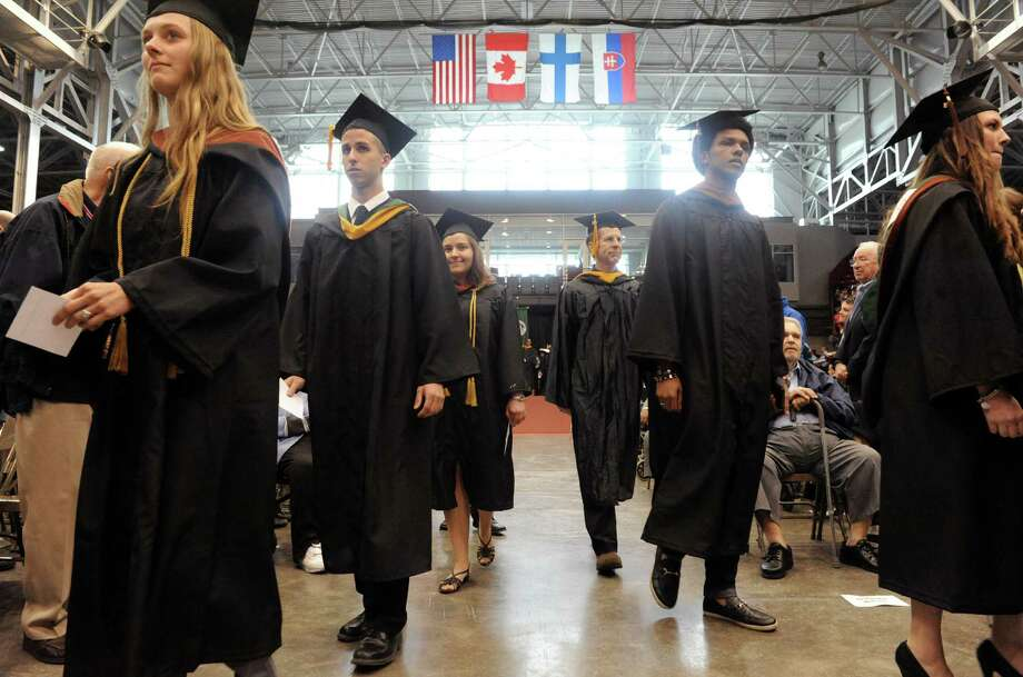 Graduates process during the Sage Colleges commencement exercises at the RPI Houston Fieldhouse on Saturday May 17, 2014 in Troy, N.Y. (Michael P. Farrell/Times Union) Photo: Michael P. Farrell / 00026741A