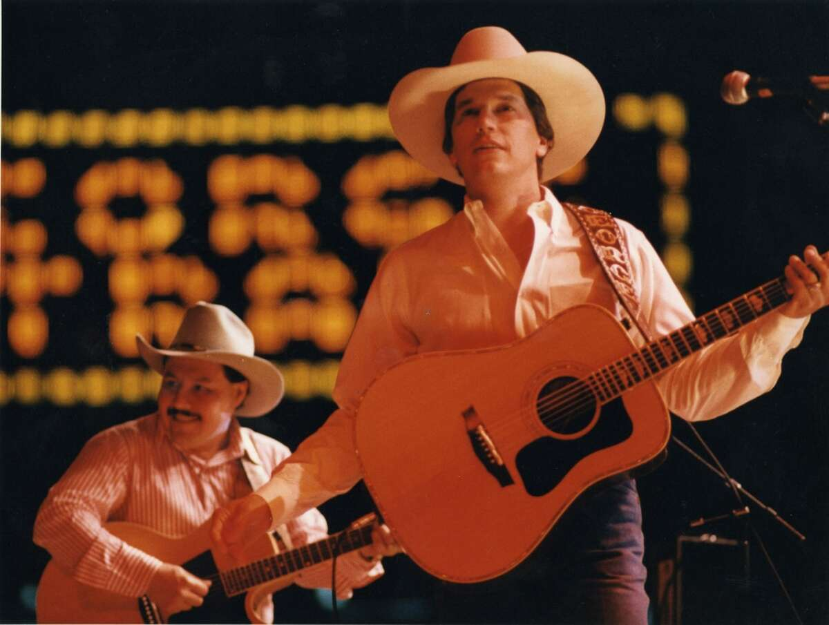 2/25/1987 - singer George Strait performs at the Houston Livestock Show & Rodeo in the Houston Astrodome.