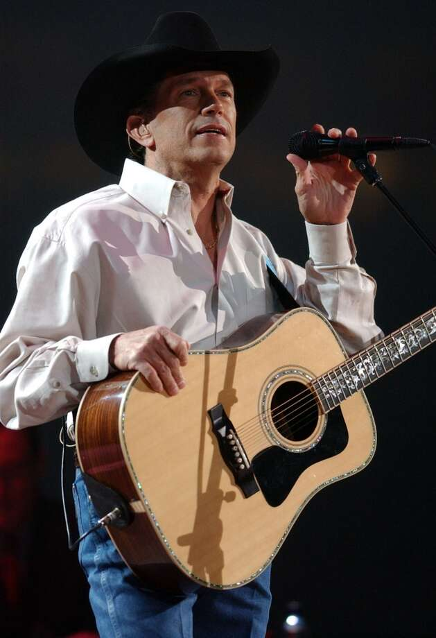 Houston Livestock Show and Rodeo opening night: George Strait performs at the Houston Livestock Show and Rodeo at Reliant Stadium Tuesday, Feb. 25, 2003 in Houston, Texas. Photo: CHRISTOBAL PEREZ, HOUSTON CHRONICLE