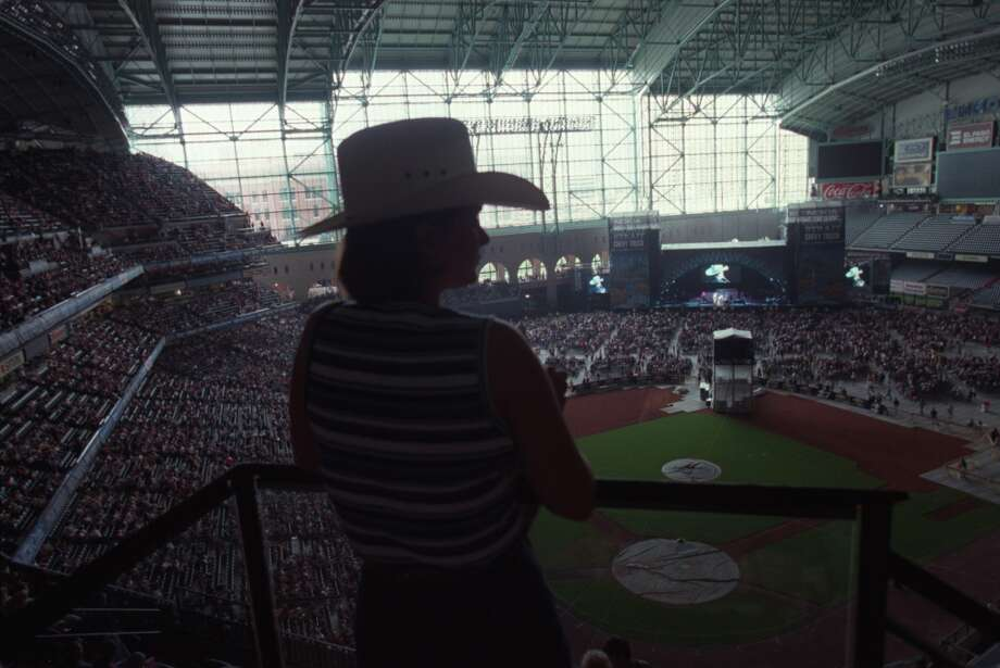At the George Strait Country Music Festival at Enron Field in Houston Sunday June 11, 2000, the first non baseball event at the facility, Lisa Morrison takes in Mark Chesnutt from the upper level. Photo: Andrew Innerarity, Houston Chronicle