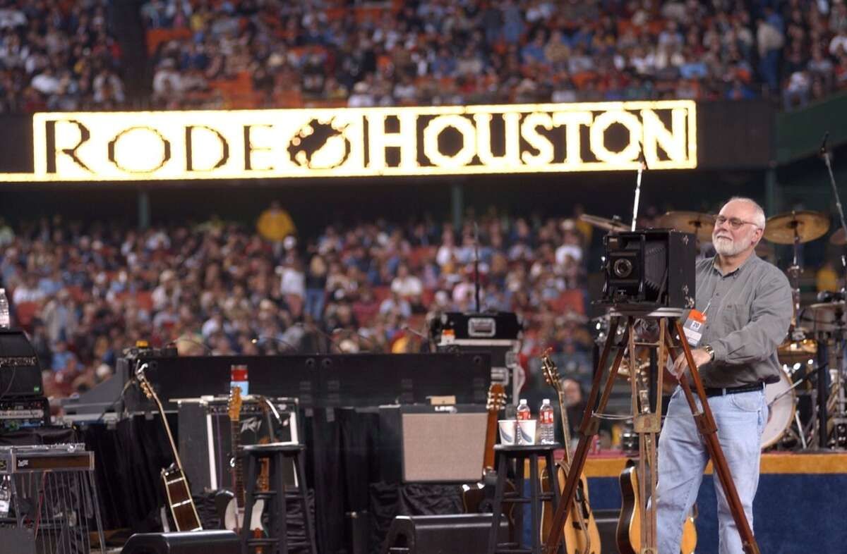 John Lawson shoots a panoramic photo of the crowd and the Astrodome before the start of the George Strait concert. Sunday, March 3, 2002