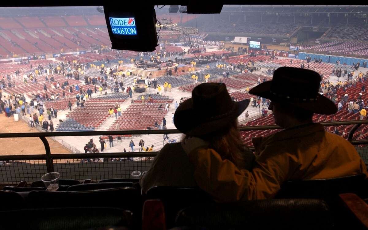 Gianna Rodriguez and her boyfriend, Ed Pawlik, of Dallas, enjoy the last of Houston's legendary Astrodome as people file out after the George Strait concert. Sunday, March 3, 2002