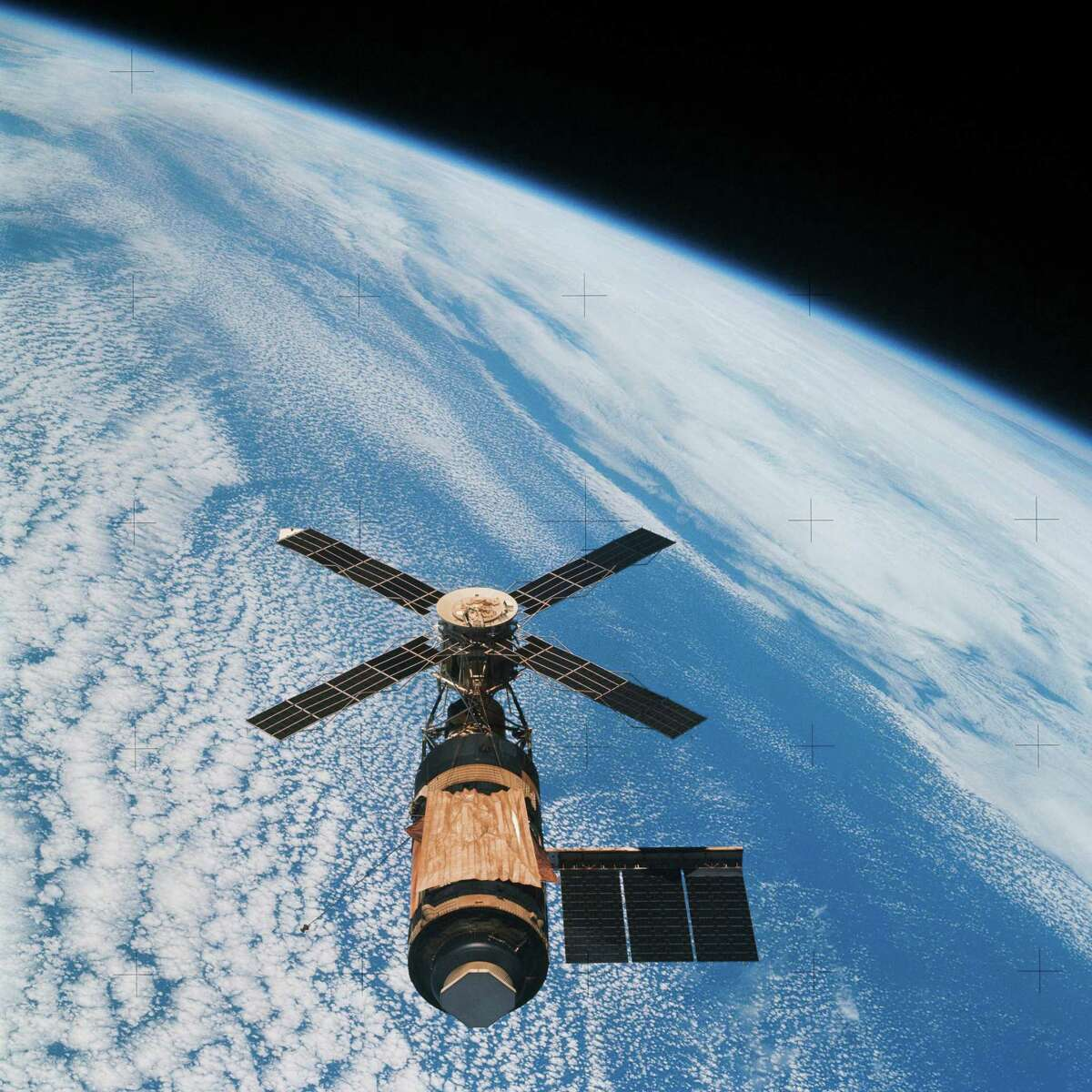 The Skylab 4 Command and Service modules photographed the Skylab space station during its final fly around before returning home.Image Credit: NASA