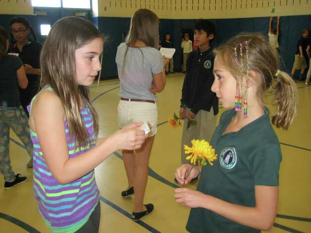 Robert C. Parker School fifth-grader Olivia Melkonian of West Sand Lake, asks a Doane Stuart student to answer a bee question during the Waggle Dance Game. The North Greenbush school?s fourth- and fifth-grade students took their Bee Show ? a presentation and game about the importance of honey bees based on their experiences as beekeepers ?to Doane Stuart School students.