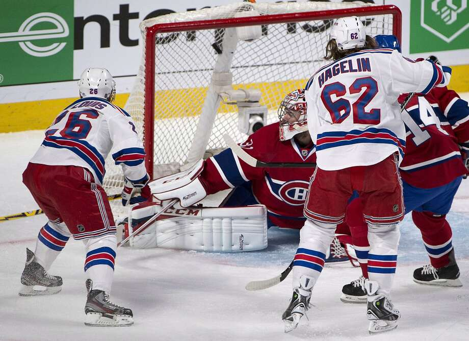Martin St. Louis (left) and other Rangers had Canadiens goalie Carey Price constantly looking over his shoulder. Photo: Adrian Wyld, Associated Press