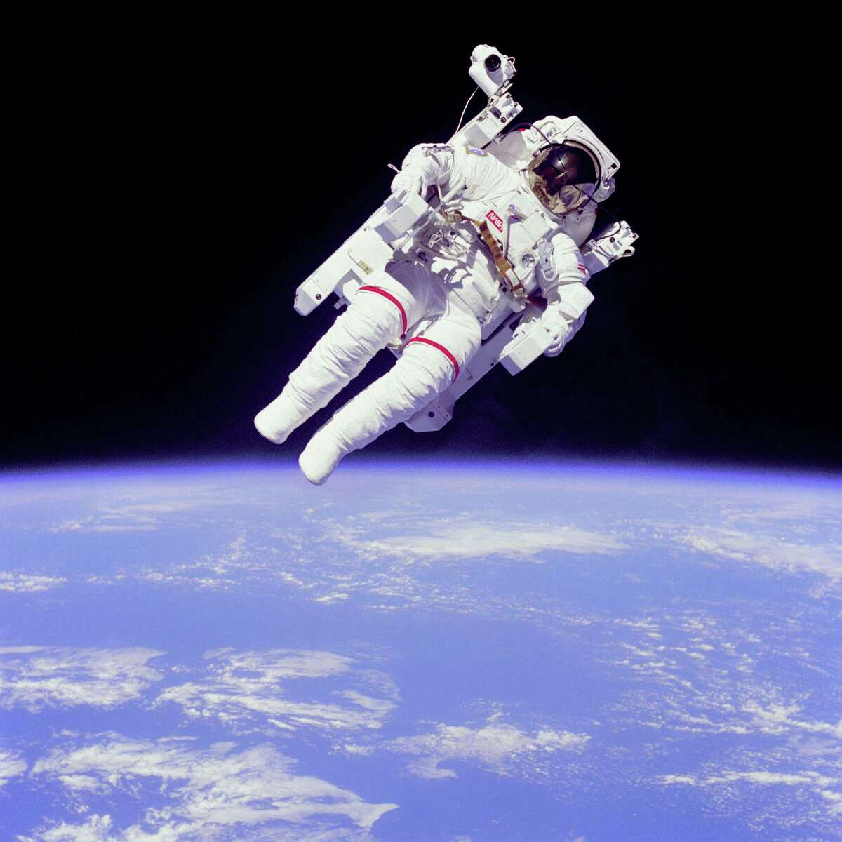 Mission Specialist Bruce McCandless II ventured further away from the confines and safety of his ship than any previous astronaut ever had in 1984. The space first was made possible by the Manned Manuevering Unit or MMU, a nitrogen jet propelled backpack. After a series of test maneuvers inside and above Challenger's payload bay, McCandless went
