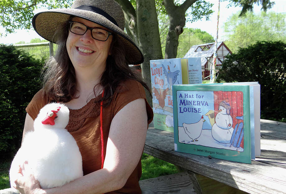 Westport Children's Librarian Lynne Perrigo with Minerva the plush toy chicken and a storybook about her read to youngsters visiting Wakeman Town Farm on Saturday. Photo: Mike Lauterborn / Westport News