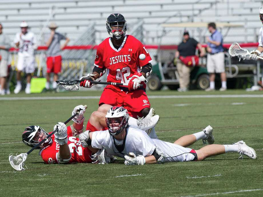 New Canaan's Kyle Smith, bottom right, and Fairfield Prep's Maxwell Trudeau, bottom left, and Austin Sims, back, look at a loose ball during Saturday's lacrosse game at New Canaan High School on May 17, 2014. Photo: Lindsay Perry / Stamford Advocate