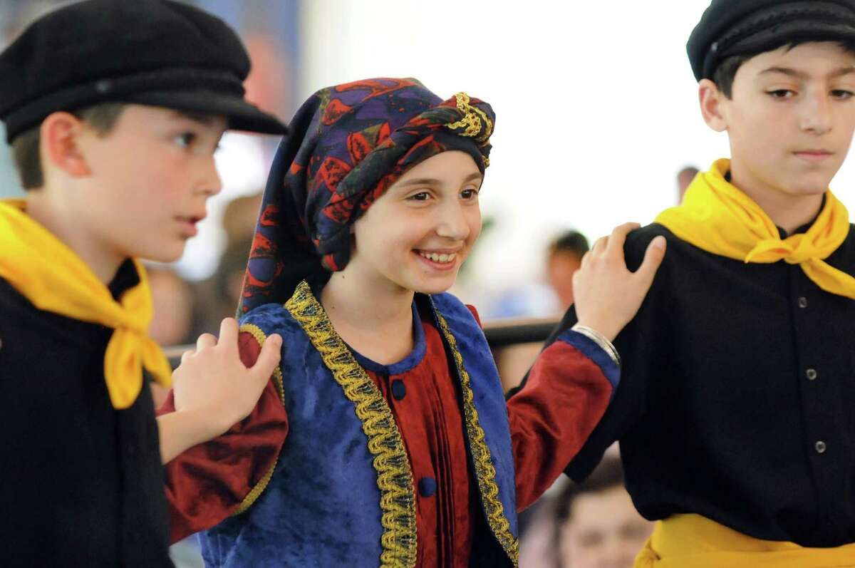Anna Cholakis, center, performs a traditional Greek dance with Dimitri Anagnostopoulos, left, and Zachary Esposito during the St. Sophia 2014 Greek Festival on Saturday, May 17, 2014, at St. Sophia Greek Orthodox Church in Albany, N.Y. The festival, which features Greek food, music and dancing, continues Sunday from noon to 7 p.m. (Cindy Schultz / Times Union)