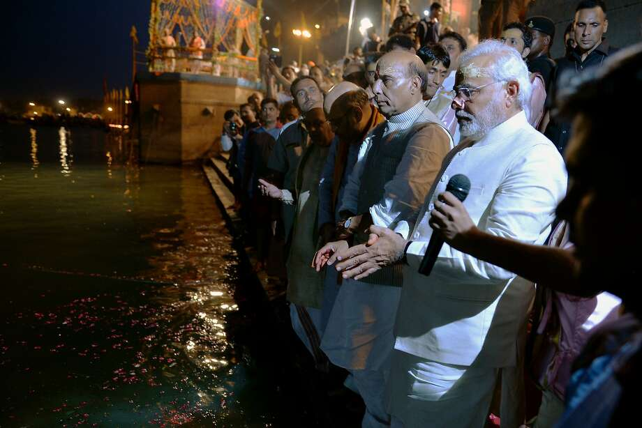 Prime Minister-elect Narendra Modi (right) performs the religious Ganga Puja ritual on the bank of the Ganges River. Photo: Manjunath Kiran, AFP/Getty Images