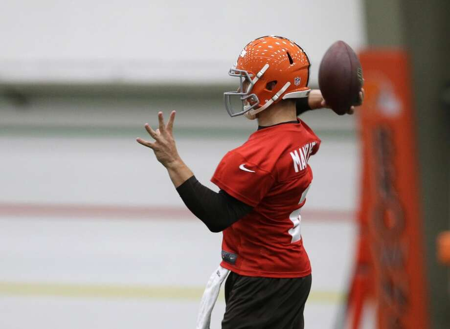 Cleveland Browns quarterback Johnny Manziel passes during a rookie minicamp practice at the NFL football team's facility in Berea, Ohio Saturday, May 17, 2014. (AP Photo/Mark Duncan) Photo: Mark Duncan, Associated Press