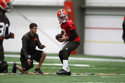 BEREA, OH - MAY 17:  Cleveland Browns draft pick Johnny Manziel takes a snap during the Cleveland Browns rookie minicamp on May 17, 2014 at the Browns training  facility in Berea, Ohio.  (Photo by David Maxwell/Getty Images) Photo: David Maxwell, Getty Images