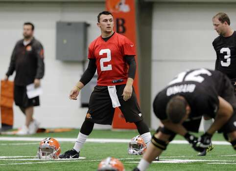 Cleveland Browns quarterback Johnny Manziel (2) stretches before a rookie minicamp practice at the NFL football team's facility in Berea, Ohio Saturday, May 17, 2014. (AP Photo/Mark Duncan) Photo: Mark Duncan, Associated Press