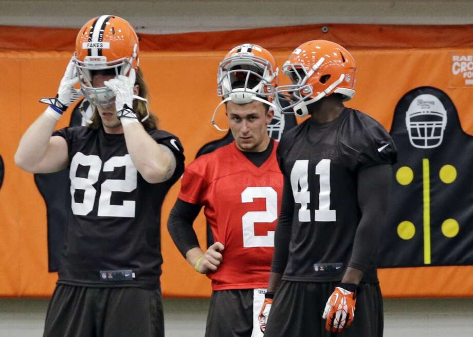 Cleveland Browns quarterback Johnny Manziel (2) warms up behind Zane Frakes (82) and Blake Jackson (41) during a rookie minicamp practice at the NFL football team's facility in Berea, Ohio Saturday, May 17, 2014. (AP Photo/Mark Duncan) Photo: Mark Duncan, Associated Press