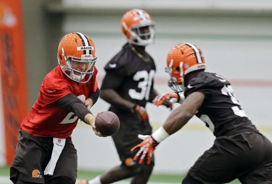 Cleveland Browns quarterback Johnny ManzielMatthew Willis during rookie minicamp practice at the NFL football team's facility in Berea, Ohio Saturday, May 17, 2014. (AP Photo/Mark Duncan) Photo: Mark Duncan, Associated Press