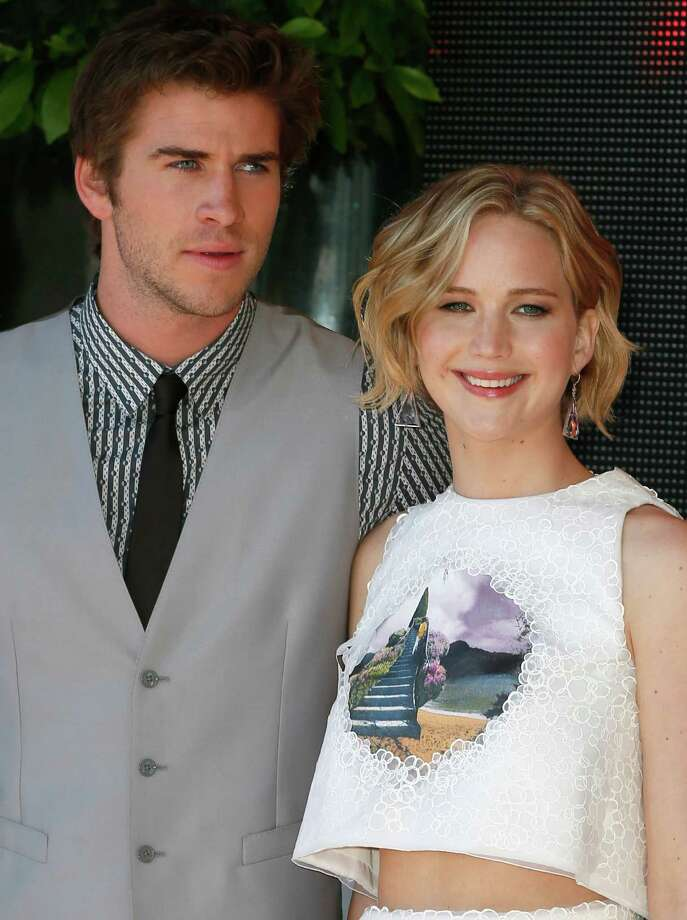 Actors Liam Hemsworth and Jennifer Lawrence pose for photographers during a photo call for Hunger Games: Mockingjay Part 1 at the 67th international film festival, Cannes, southern France, Saturday, May 17, 2014. Photo: Alastair Grant, AP / AP