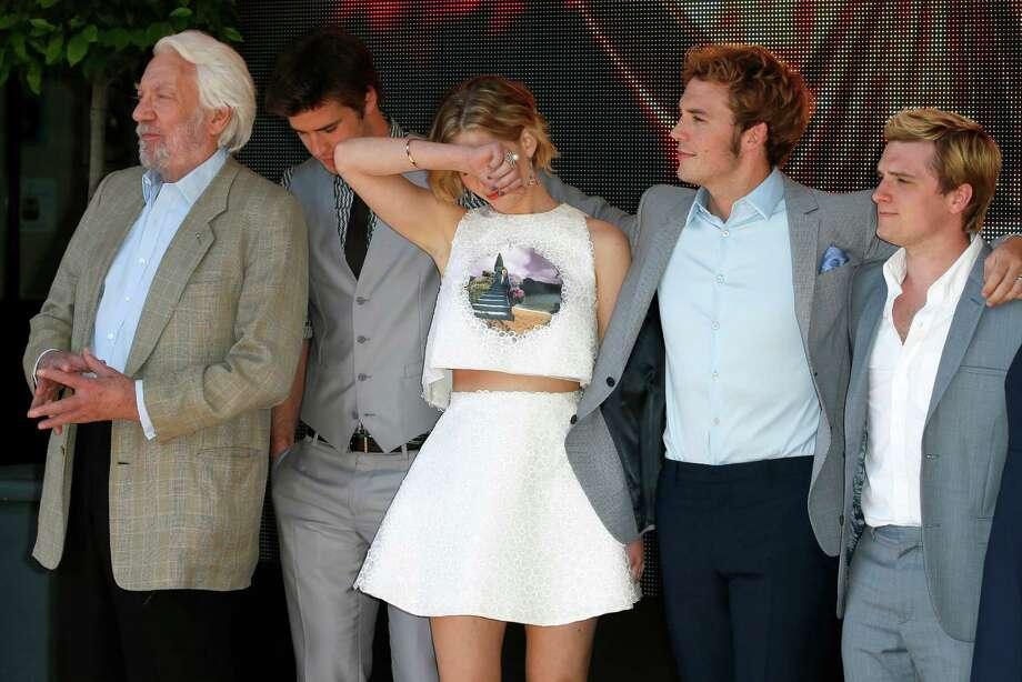 From left, actors Donald Sutherland, Liam Hemsworth, Jennifer Lawrence, Sam Claflin and Josh Hutcherson during a photo call for Hunger Games: Mockingjay Part 1 at the 67th international film festival, Cannes, southern France, Saturday, May 17, 2014. Photo: Alastair Grant, AP / AP