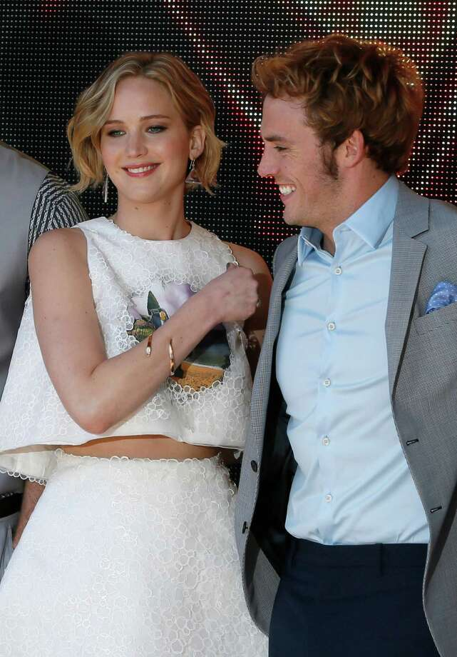 Jennifer Lawrence and Sam Clafin pose for photographers during a photo call for Hunger Games: Mockingjay Part 1 at the 67th international film festival, Cannes, southern France, Saturday, May 17, 2014. Photo: Alastair Grant, AP / AP