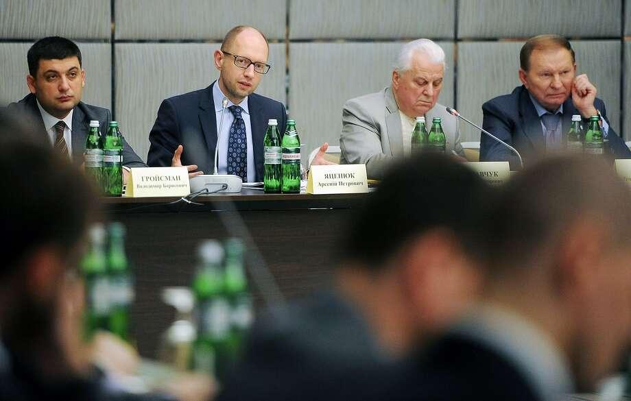Ukrainian acting Prime Minister Arseniy Yatsenyuk (second from left) speaks at the Kiev summit. Photo: Andrew Kravchenko, AFP/Getty Images