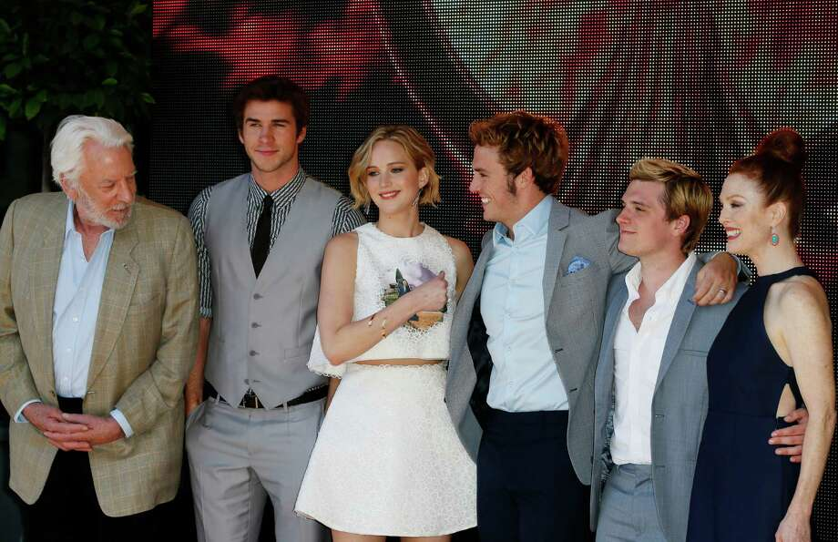 From left, actors Donald Sutherland, Liam Hemsworth, Jennifer Lawrence, Sam Clafin, Josh Hutcherson and Julianne Moore pose for photographers during a photo call for Hunger Games: Mockingjay Part 1 at the 67th international film festival, Cannes, southern France, Saturday, May 17, 2014. Photo: Alastair Grant, AP / AP2014