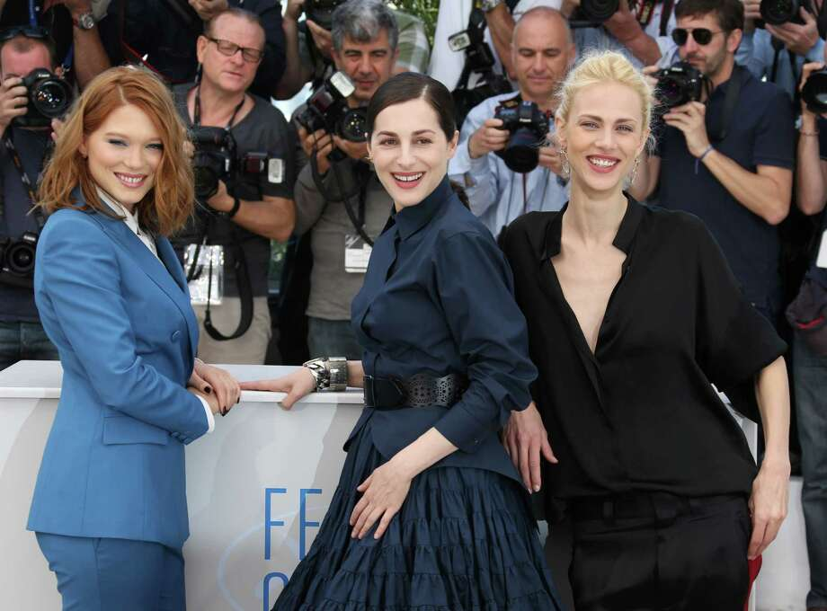 From left, actors Lea Seydoux, Amira Casar and Aymeline Valade pose for photographers during a photo call for Saint-Laurent at the 67th international film festival, Cannes, southern France, Saturday, May 17, 2014. Photo: Joel Ryan, Joel Ryan/Invision/AP / Invision