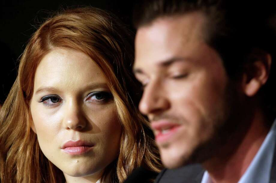 Actress Lea Seydoux, left, listens to actor Gaspard Ulliel speak during a press conference for Saint-Laurent at the 67th international film festival, Cannes, southern France, Saturday, May 17, 2014. Photo: Thibault Camus, AP / AP2014