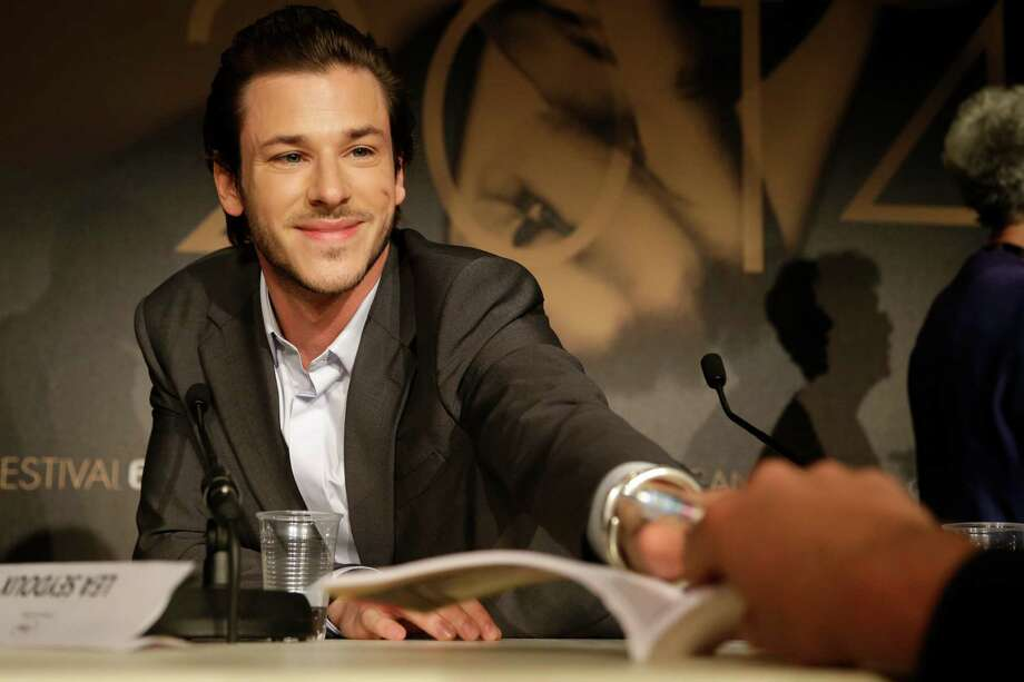 Actor Gaspard Ulliel signs autographs during a press conference for Saint-Laurent at the 67th international film festival, Cannes, southern France, Saturday, May 17, 2014. Photo: Thibault Camus, AP / AP