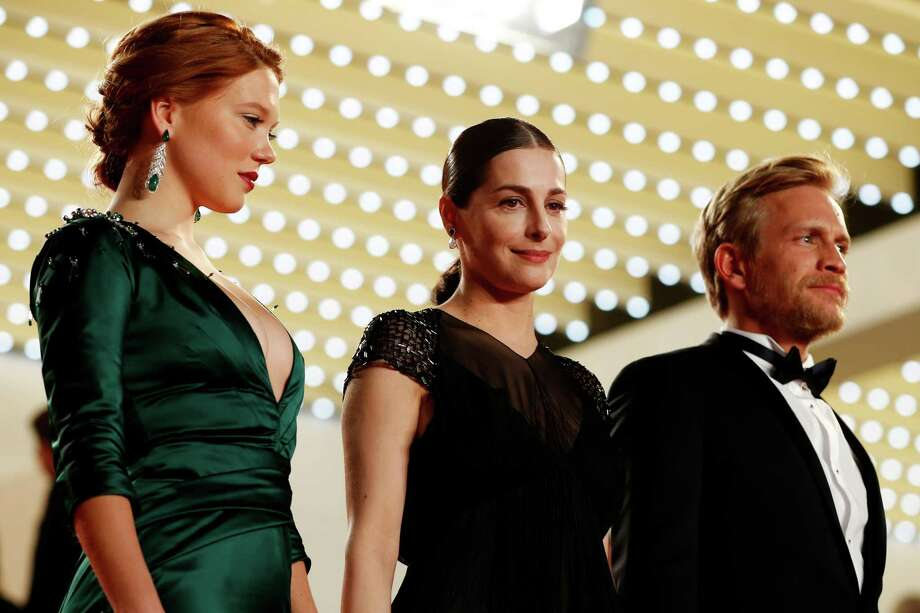 From left, actress Lea Seydoux, actress Amira Casar and actor Jeremie Renier pose at the top of the red carpet after the screening of Saint-Laurent at the 67th international film festival, Cannes, southern France, Saturday, May 17, 2014. Photo: Alastair Grant, AP / AP