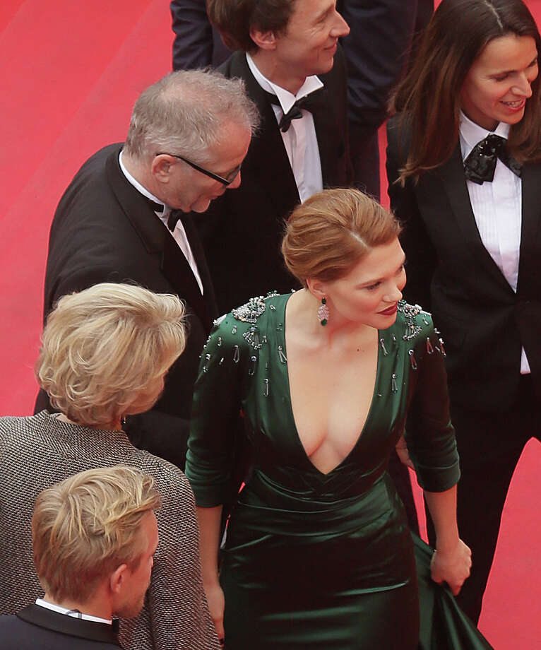 Actress Lea Seydoux, center, stands at the top of the red carpet during arrivals for the screening of Saint-Laurent at the 67th international film festival, Cannes, southern France, Saturday, May 17, 2014. Photo: Virginia Mayo, AP / AP