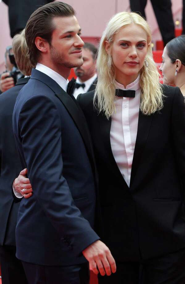 Actress Aymeline Valade, right, and actor Gaspard Ulliel pose for photographers as they arrive for the screening of Saint-Laurent at the 67th international film festival, Cannes, southern France, Saturday, May 17, 2014. Photo: Thibault Camus, AP / AP