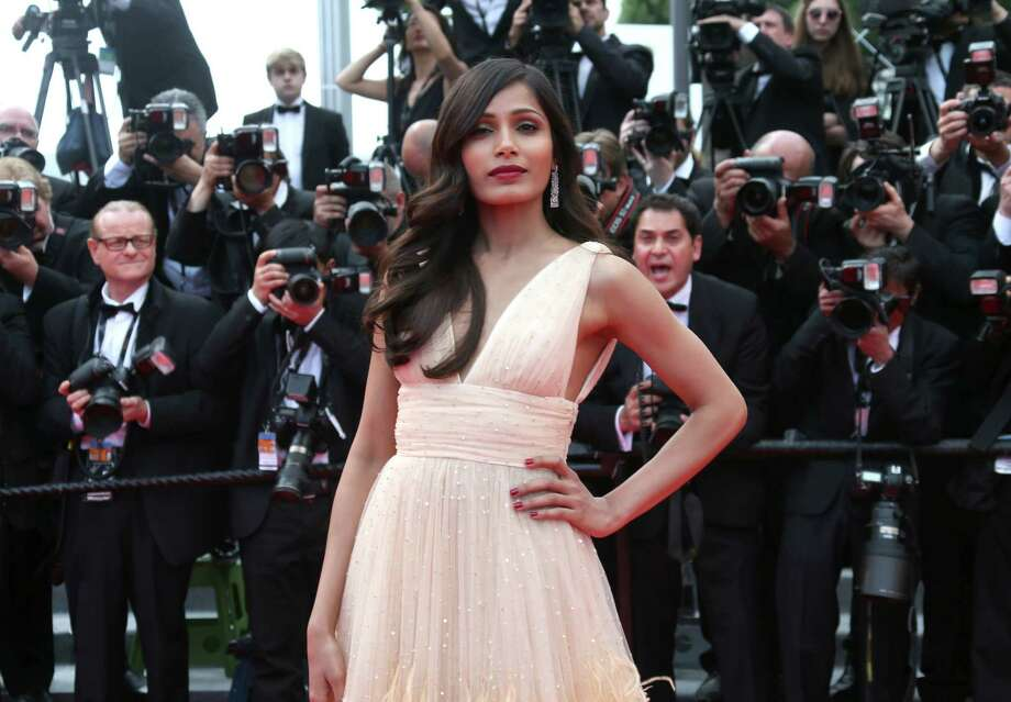 Freida Pinto - A sweet dress is best with a sassy pose.  Photo: Joel Ryan, Joel Ryan/Invision/AP / Invision