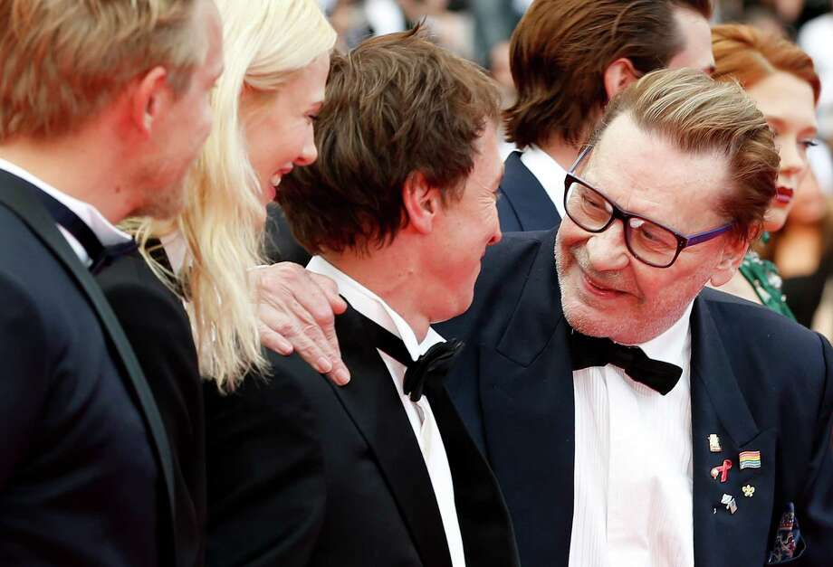 Actor Helmut Berger, right, speaks with from left, actor Jeremie Renier, actress Aymeline Valade, and director Bertrand Bonello for the screening of Saint-Laurent at the 67th international film festival, Cannes, southern France, Saturday, May 17, 2014. Photo: Alastair Grant, AP / AP