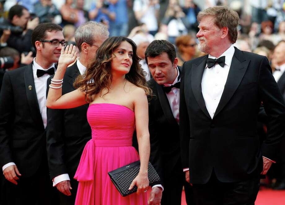 Actress Selma Hayek-Pinault , center, waves as she arrives for the screening of Saint-Laurent at the 67th international film festival, Cannes, southern France, Saturday, May 17, 2014. Photo: Alastair Grant, AP / AP