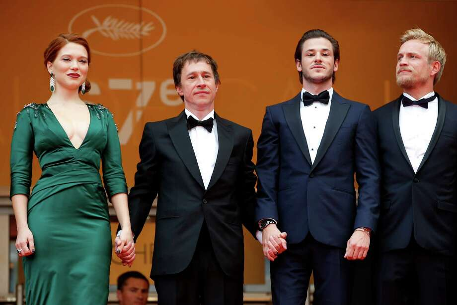 From left, actress Lea Seydoux, director Bertrand Bonello, actor Gaspard Ulliel and actor Jeremie Renier stand at the top of the steps as they arrive for the screening of Saint-Laurent at the 67th international film festival, Cannes, southern France, Saturday, May 17, 2014. Photo: Alastair Grant, AP / AP