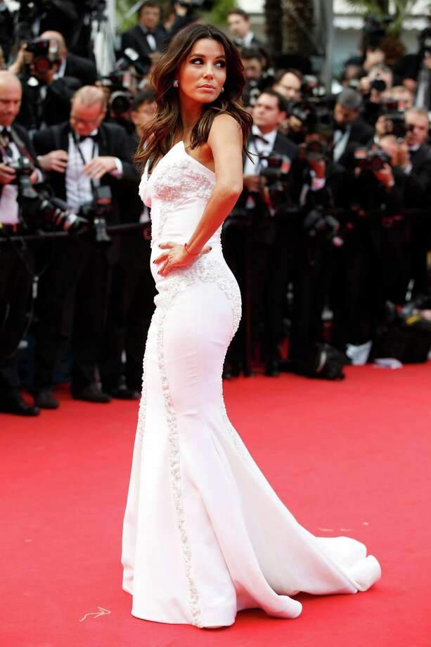 Actress Eva Longoria poses for photographers as she arrives for the screening of Saint-Laurent at the 67th international film festival, Cannes, southern France, Saturday, May 17, 2014. Photo: Alastair Grant, AP / AP2014