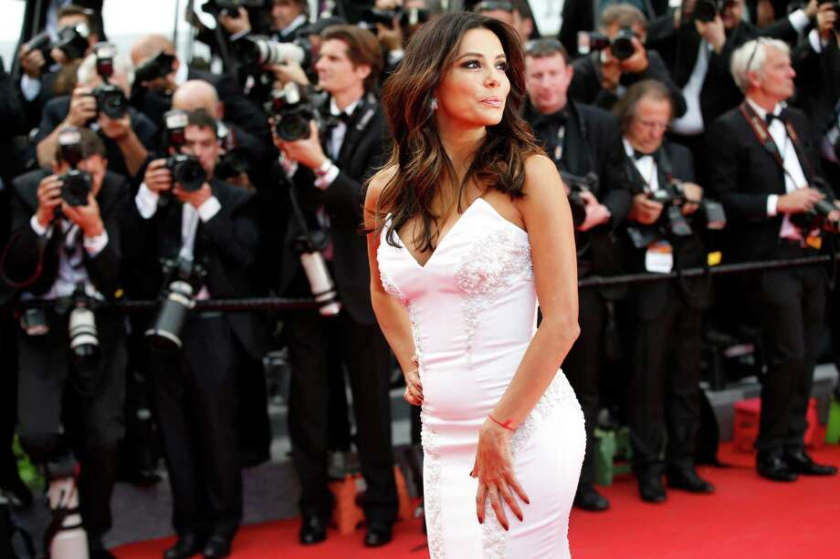 Actress Eva Longoria poses for photographers as she arrives for the screening of Saint-Laurent at the 67th international film festival, Cannes, southern France, Saturday, May 17, 2014. Photo: Alastair Grant, AP / AP