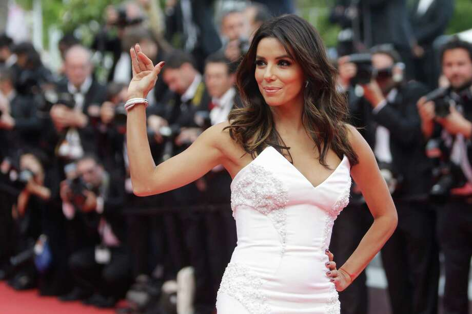 Actress Eva Longoria poses for photographers as she arrives for the screening of Saint-Laurent at the 67th international film festival, Cannes, southern France, Saturday, May 17, 2014. Photo: Thibault Camus, AP / AP