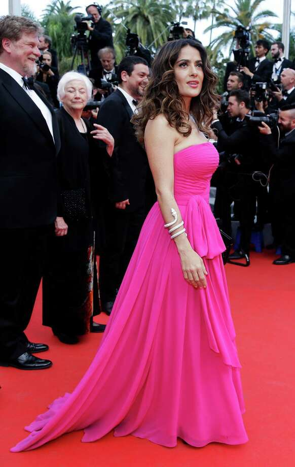 Actress Salma Hayek poses for photographers as she arrives for the screening of Saint-Laurent at the 67th international film festival, Cannes, southern France, Saturday, May 17, 2014. Photo: Thibault Camus, AP / AP