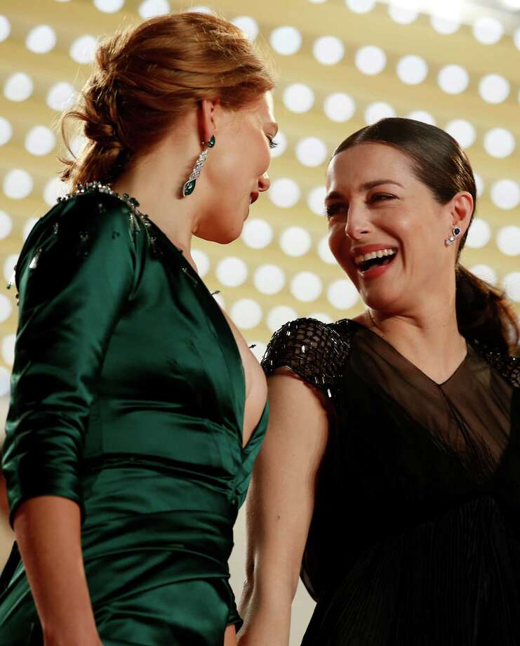 Actress Lea Seydoux, left, speaks with actress Amira Casar at the top of the red carpet after the screening of Saint-Laurent at the 67th international film festival, Cannes, southern France, Saturday, May 17, 2014. Photo: Alastair Grant, AP / AP