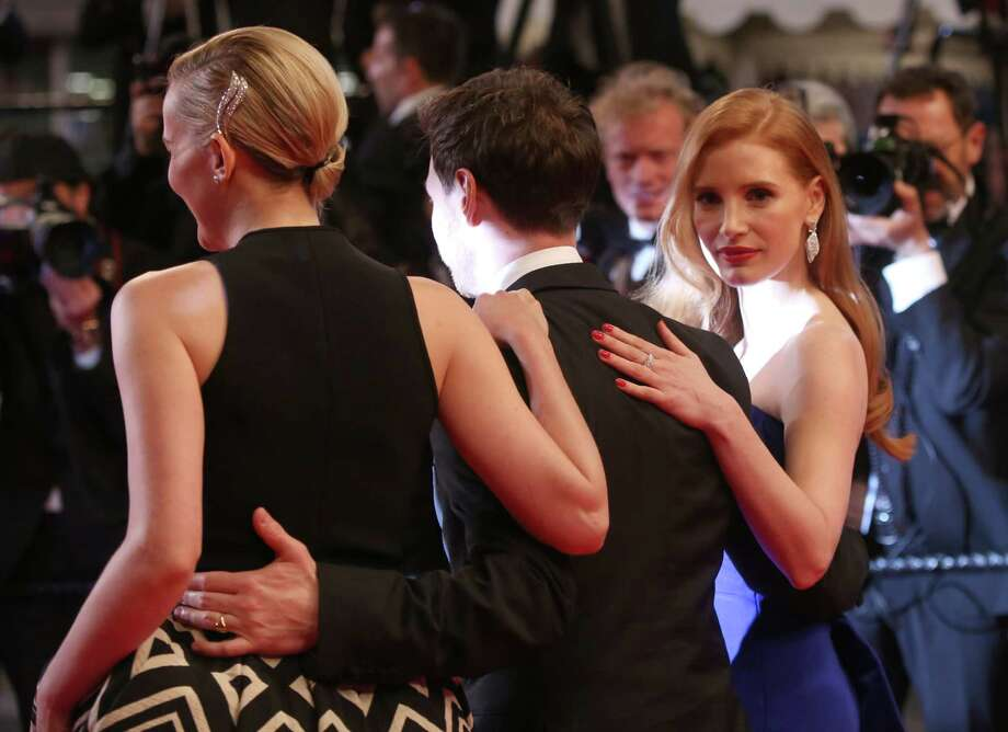 From left, actors Jess Weixler, James McAvoy and Jessica Chastain arrive on the red carpet for the screening of Wild Tales (Relatos Salvajes) at the 67th international film festival, Cannes, southern France, Saturday, May 17, 2014. Photo: Joel Ryan, Joel Ryan/Invision/AP / Invision