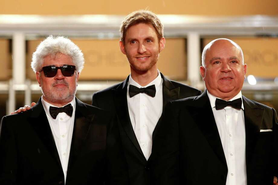 From left, producer Pedro Almodovar, director Damian Szifron and producer Austin Almodovar pose at the top of the red carpet as they arrive for the screening of Wild Tales (Relatos Salvajes) at the 67th international film festival, Cannes, southern France, Saturday, May 17, 2014. Photo: Alastair Grant, AP / AP