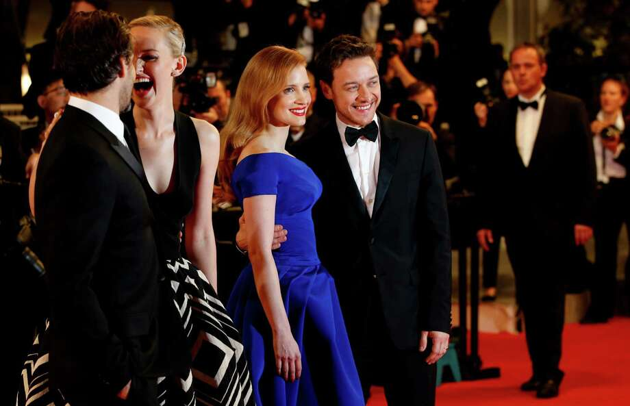 Actress Jessica Chastain, center left, poses with actor James McAvoy as they arrive for the screening of Wild Tales (Relatos Salvajes) at the 67th international film festival, Cannes, southern France, Saturday, May 17, 2014. Photo: Alastair Grant, AP / AP