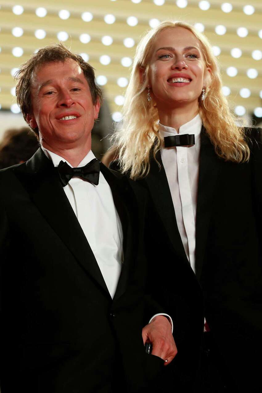 Actress Aymeline Valade, right, and director Bertrand Bonello pose for photographers following the screening of Wild Tales (Relatos Salvajes) at the 67th international film festival, Cannes, southern France, Saturday, May 17, 2014.
