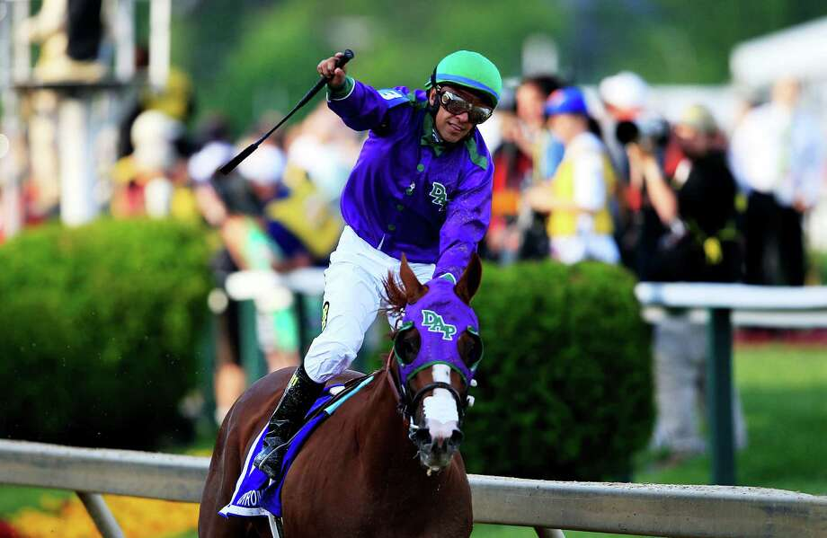 BALTIMORE, MD - MAY 17:  Victor Espinoza celebrates atop California Chrome #3 after winning the 139th running of the Preakness Stakes at Pimlico Race Course on May 17, 2014 in Baltimore, Maryland. Photo: Rob Carr, Getty Images / 2014 Getty Images